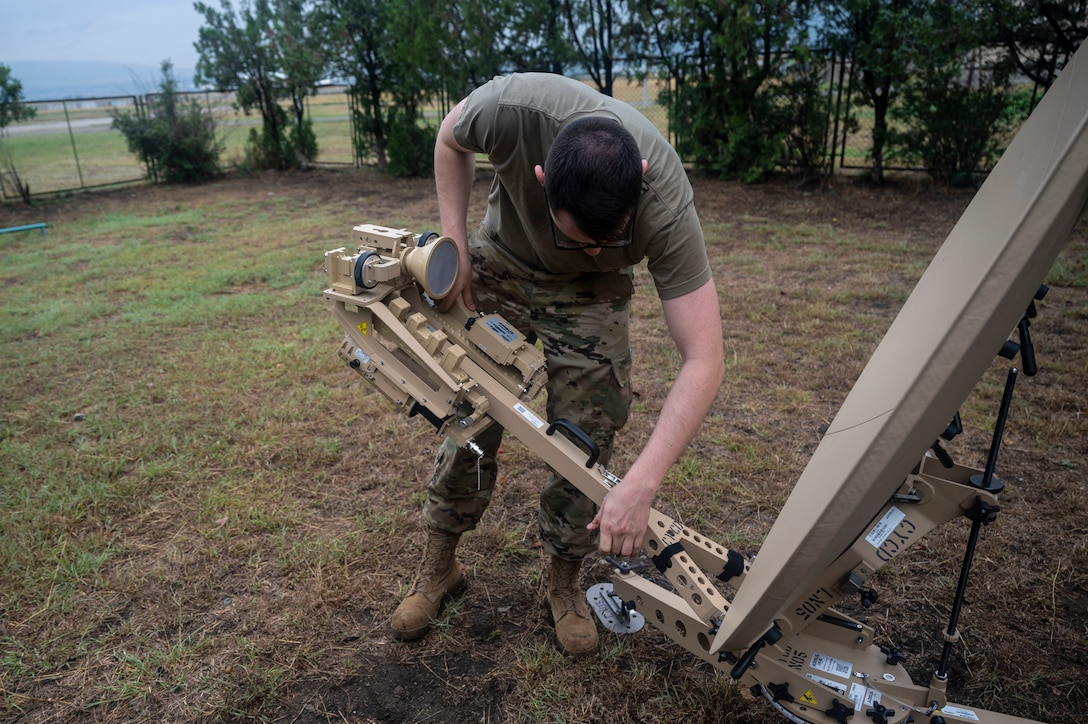 U.S. Air Force Airman First Class Isaac Peebles, 1st Combat Communications Squadron radio frequency transmission systems, builds a tactical satellite during exercise Agile Spirit 21