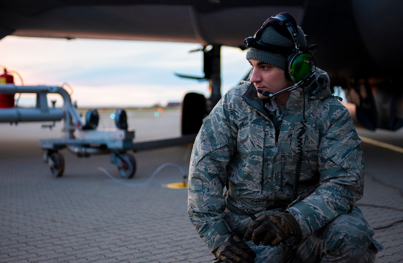 Staff Sgt. Elliot St. Laurent, an Air National Guard crew chief with the 168th Wing, Eielson AirForce Base, Alaska, prepares to refuel a KC-135R Stratotanker at Ørland Air Station, Norway, March 10, 2020. Aircraft and personnel from the Air National Guard, Air Force Reserve, and active duty Air Force are working together in support of Exercise Cold Response 20. CR20 is designed to enhance military capabilities and allied cooperation in high-intensity warfighting in a challenging Arctic environment with rugged terrain and extreme cold weather. We are able to maintain a global presence through the combined efforts of our active duty, National Guard, and Reserve partners. (U.S. Air National Guard photo by Master Sgt. James Michaels)