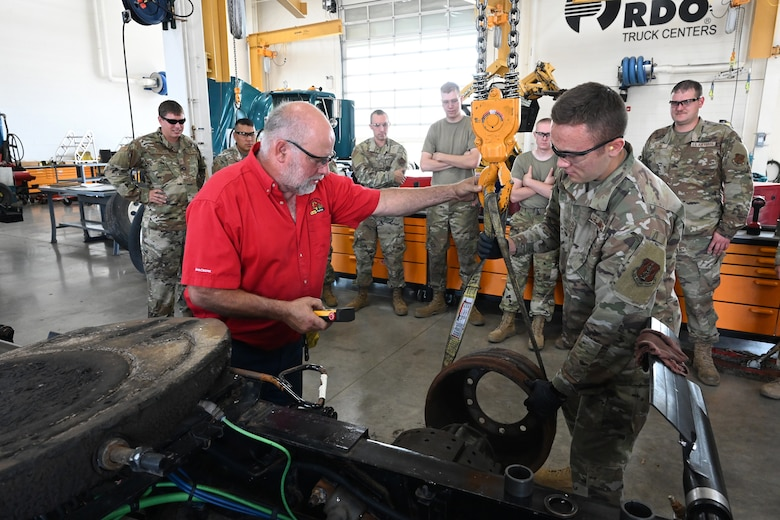 Air brake systems instructor Jim Bainer, red shirt, directs Airman 1st Class Mason Heimkes, of the 119th Logistics Readiness Squadron, as he provides instruction for Air National Guard students in the 'lab' training at Minnesota State Community College (M State), Moorhead, Minn., July 22, 2021.