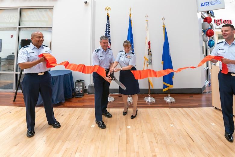 Airmen cutting ribbon.