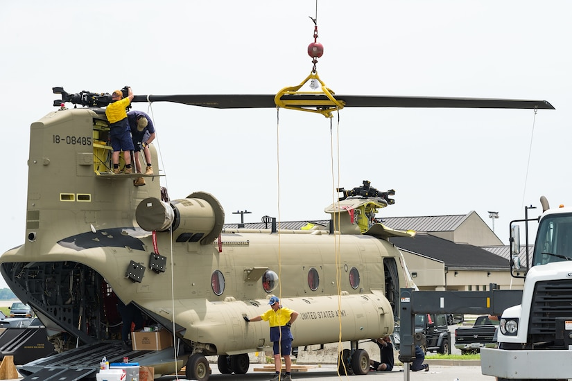 Boeing Defence Australia maintenance team members prepare a CH-47F Chinook helicopter for shipment at Dover Air Force Base, Del., June 9, 2021. BDA maintenance personnel readied two Chinooks for shipment aboard a C-5M Super Galaxy as part of the U.S. government's Foreign Military Sales program.