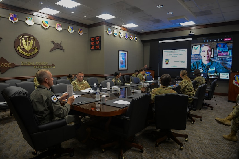 Military members meeting in a conference room.