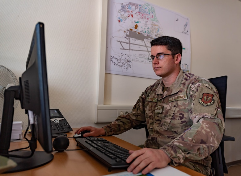 U.S. Air Force Senior Airman James Jones, a controlled movement area escort and project manager assigned to the 86th Civil Engineering Squadron,  schedules escorts' shifts at Ramstein Air Base, Germany, July 28, 2021. Jones has been focusing on escorts and airfield construction with construction season at its peak but is at the same time learning how to read and design plans and how to write up airfield construction waivers for future projects.   (U.S. Air Force photo by Airman Jared Lovett)