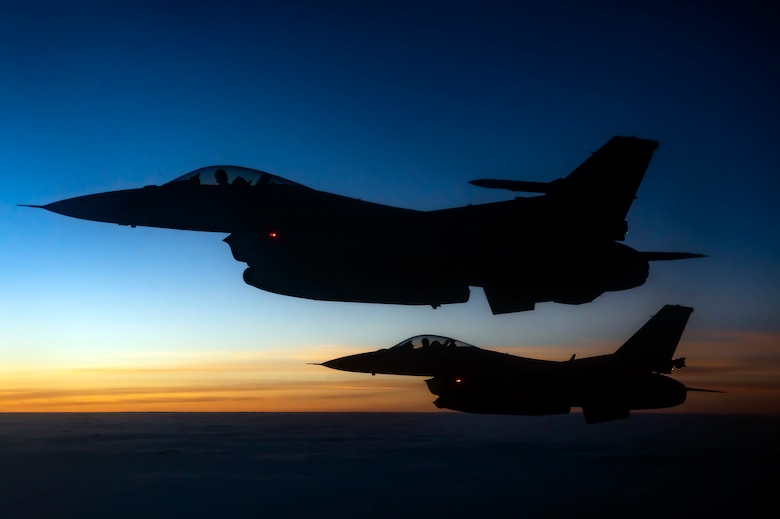 Two U.S. Air Force F-16 Fighting Flacon Aircraft fly Through The Sky