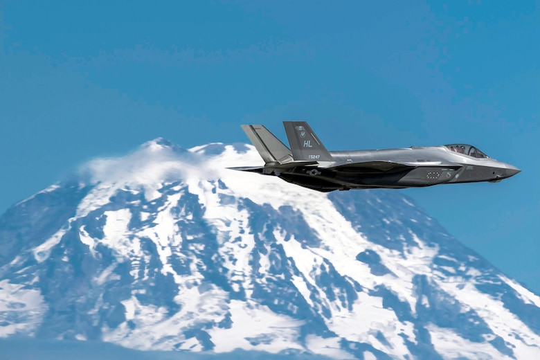 F-35A Lighting II Flying with Tacoma Mountains on Flank
