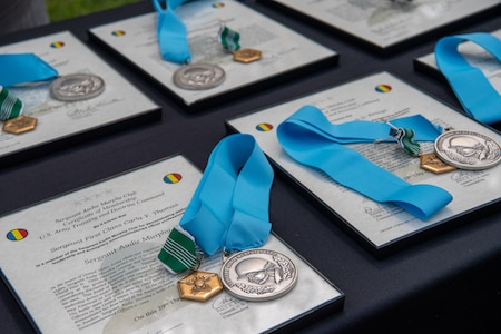 medals and awards laid out on a table.