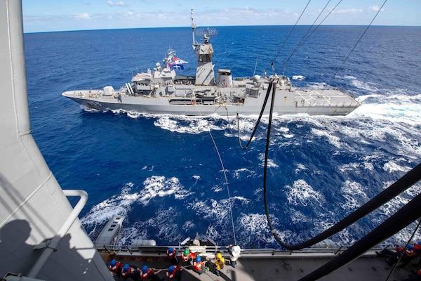 The Royal Australian Navy frigate HMAS Ballarat (FFH 155) receives fuel from the forward-deployed amphibious assault ship USS America (LHA 6) during a fueling-at-sea.