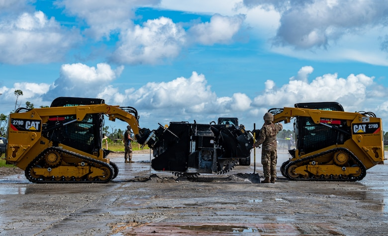 Photo of two track loaders