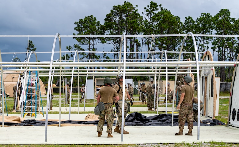 Photo of Airmen under temporary shelter