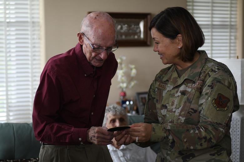 Chief Master Sergeant of the Air Force JoAnne S. Bass gives retired Chief Master Sgt. of the Air Force James McCoy a patch