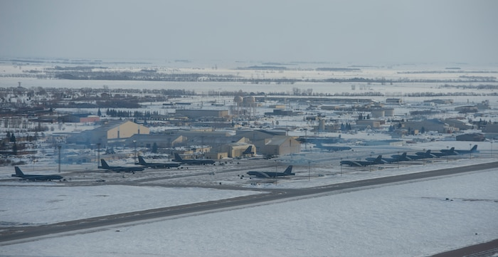 B-52 Stratofortresses are parked along the flightline at Minot Air Force Base