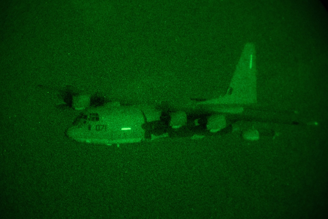 Marines with Marine Aerial Refueler Transport Squadron (VMGR) 252 fly a KC-130J Hercules during night operations at Marine Corps Air Station Cherry Point, North Carolina, July 22, 2021. VMGR-252 trained in assault support and night operations to ensure readiness and proficiency within the unit. VMGR-252 is a subordinate unit of 2nd Marine Aircraft Wing, the aviation combat element of II Marine Expeditionary Force. (U.S. Marine Corps photo by Lance Cpl. Elias E. Pimentel III)
