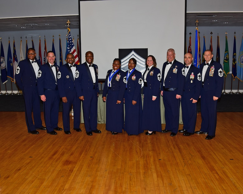 U.S. Air Force Senior Master Sgts. Melissa D. Bridges (center left) and Joi T. Washington (center right), are joined by Chief Master Sgts., retired and active duty for a group photo at the Chief Induction ceremony, July 22, 2021 on Columbus Air Force Base, Miss. The Chief Induction ceremony is a separate recognition event from the monthly promotion ceremony that honors the singularly distinctive accomplishments of those inducted to the rank of Chief. (Multimedia Services photo by Melissa A. Duncan-Doublin)