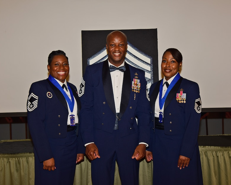 U.S. Air Force Senior Master Sgts. Melissa D. Bridges (left) and Joi T. Washington (right) pose for a photo with Chief Master Sgt. Antonio Cooper, 14th Flying Training Wing command chief at the Chief Induction ceremony, July 22, 2021 on Columbus Air Force Base, Miss. Chief Master Sergeants are able to serve as Squadron Superintendents, Group Superintendents, First Sergeants and Command Chief Master Sergeants, each with its own unique duty responsibilities. (Multimedia Services photo by Melissa A. Duncan-Doublin)