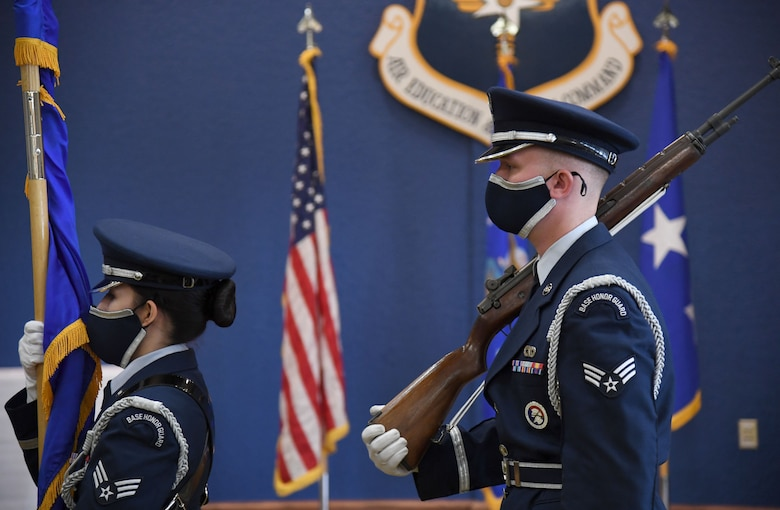 Keesler Honor Guard members present the colors during the Second Air Force change of command ceremony inside the Bay Breeze Event Center at Keesler Air Force Base, Mississippi, July 30, 2021. The ceremony is a symbol of command being exchanged from one commander to the next. Maj. Gen. Andrea Tullos relinquished command of the Second Air Force to Maj. Gen. Michele Edmondson. (U.S. Air Force photo by Kemberly Groue)
