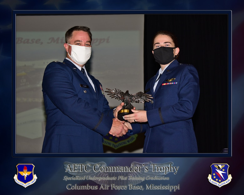 U.S. Air Force 1st Lt. Raina Cerniglia, 14th Flying Training Wing SUPT graduate, receives one of three Order of Daedalians AETC Commanders Trophy's, July 30, 2021, on Columbus Air Force Base, Miss. The Order of Daedalians is America's premier fraternal organization of military aviators and is presented to the class's most outstanding graduates.  (U.S. Air Force photo by Melissa Duncan-Doublin)