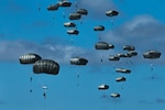 U.S. Army paratroopers with the 3rd Battalion, 509th Parachute Infantry Regiment, 4th Infantry Brigade Combat Team (Airborne), jump onto a drop zone as part of a simulated Joint Forcible Entry Operation during Exercise Talisman Sabre 21 in Charters Towers, Queensland, Australia, July 28, 2021. This event is part of a larger simulated JFEO overseen by the U.S. Army's 4th Infantry Division Forward Command Post acting as the Combined Land Forces Component Command headquarters for this portion of TS21. TS21 supports the U.S. National Defense Strategy by enhancing the ability to protect the homeland and provide combat-credible forces to address the full range of potential security concerns in the Indo-Pacific.