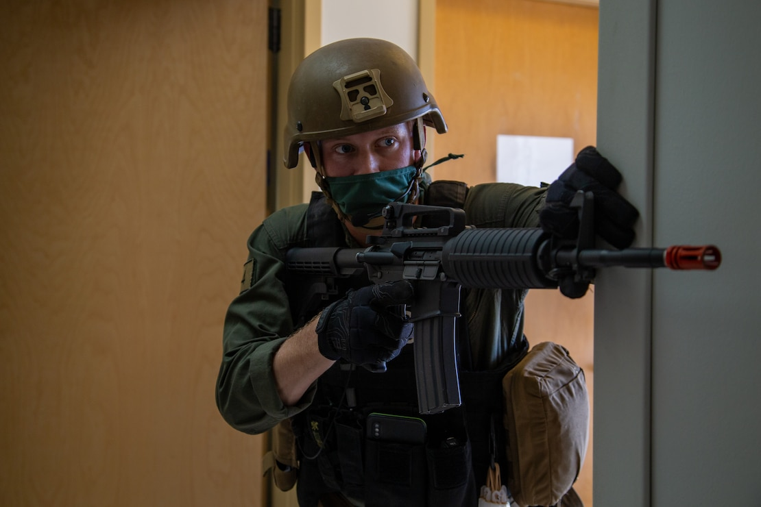 U.S. Marine Corps Cpl. Jonathan D. Moore, an assistant team leader for the Special Reaction Team with the Provost Marshal Office, Headquarters and Headquarters Squadron, provides security during Exercise Desert Fire 2021 at the Naval Branch Health Clinic on Marine Corps Air Station Yuma, Ariz., July 28, 2021. Desert Fire is an active-shooter drill implemented to test, evaluate and improve the response and preparedness of first responders with the air station.  (U.S. Marine Corps photo by Lance Cpl. Gabrielle Sanders)