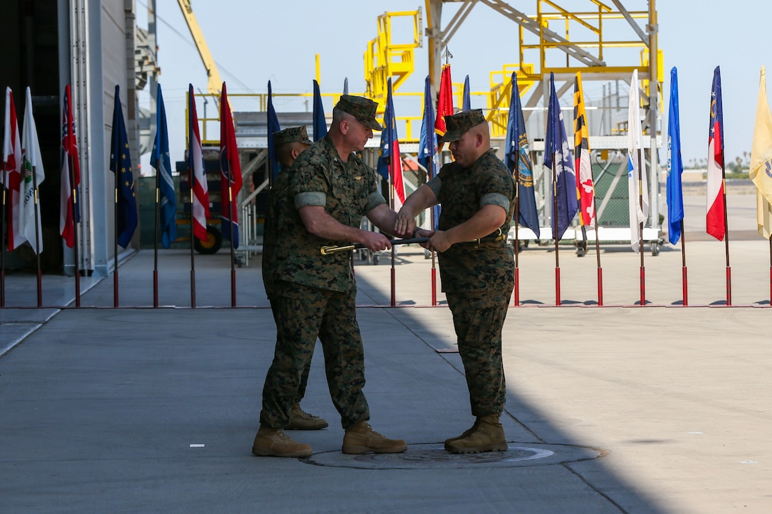 U.S. Marine Corps Col. Bryon Sullivan passes the sword to Sgt. Maj. Frank Gratacos during a change of command ceremony on Marine Corps Air Station Yuma, Ariz., June 15, 2021. The passing of the sword symbolizes the relief of duty from Sgt. Maj. Larry Buenafe as Marine Operational Test and Evaluation Squadron 1 sergeant major by Sgt. Maj. Gratacos. (U.S. Marine Corps photo by Lance Cpl. Gabrielle Sanders)