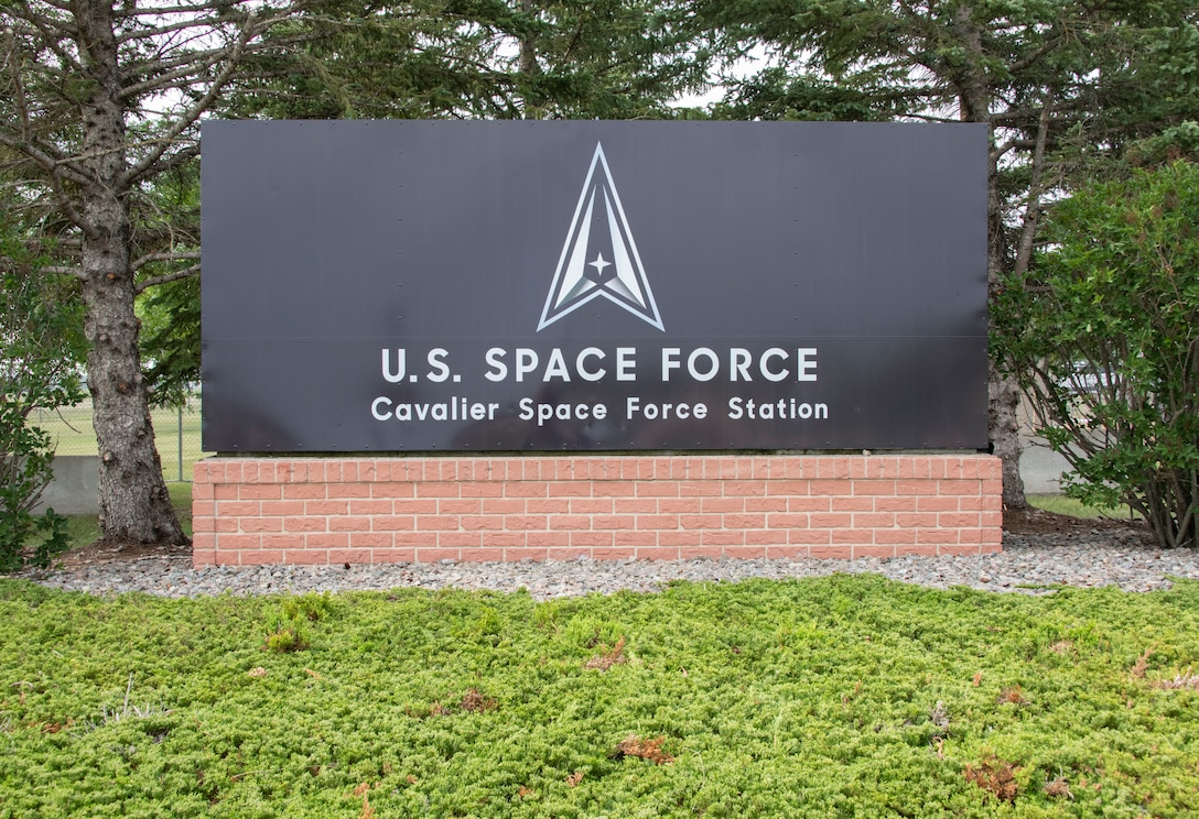 The Cavalier Space Force Station sign is unveiled during the renaming ceremony at Cavalier Space Force Station, N.D., July 30, 2021.