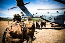 U.S. Marines from 1st Battalion, 3d Marines, load up into a CH-53 Super Stallion attached to Marine Heavy Helicopter Squadron 463 during an insertion and extraction training event, Marine Corps Base Hawaii, July 22, 2021. As a host platform to all elements of the Marine Air Ground Task Force, Marine Corps Base Hawaii provides the necessary environment to produce readiness in the air, on land and at sea. (U.S. Marine Corps photo by Lance Cpl. Brandon Aultman)