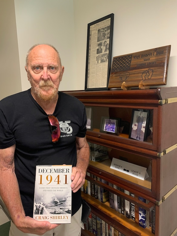Retired Master Sgt. Robert Duit, attends the official opening of a lending library named after him in the Pacific Air Forces Headquarters building at Joint Base Pearl Harbor-Hickam, Hawaii, June 6, 2021. The library was dedicated by Robert's son, U.S. Air Force Chief Master Sgt. Paul Duit, PACAF, in honor of his father's legacy as a pararescueman during the Vietnam War. (Courtesy Photo)