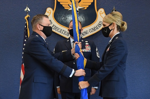 U.S. Air Force Lt. Gen. Brad Webb, commander of Air Education and Training Command, presents the guidon to Maj. Gen. Michele Edmondson, Second Air Force commander, during the Second Air Force change of command ceremony inside the Bay Breeze Event Center at Keesler Air Force Base, Mississippi, July 30, 2021. The ceremony is a symbol of command being exchanged from one commander to the next. Edmondson took command of the Second Air Force from Maj. Gen. Andrea Tullos. (U.S. Air Force photo by Kemberly Groue)