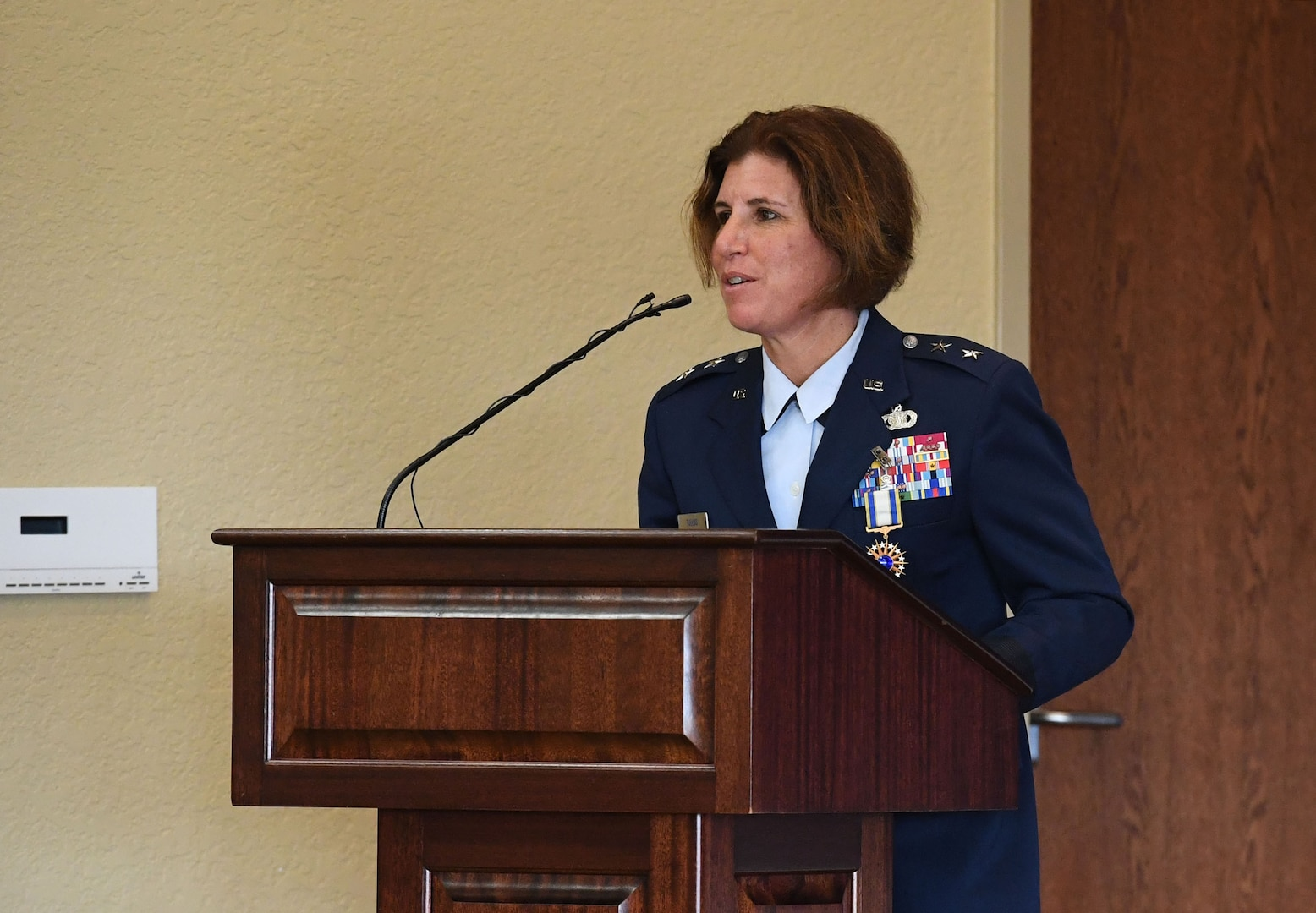 U.S. Air Force Maj. Gen. Andrea Tullos, Second Air Force commander, delivers remarks during the Second Air Force change of command ceremony inside the Bay Breeze Event Center at Keesler Air Force Base, Mississippi, July 30, 2021. The ceremony is a symbol of command being exchanged from one commander to the next. Tullos relinquished command of the Second Air Force to Maj. Gen. Michele Edmondson. (U.S. Air Force photo by Kemberly Groue)