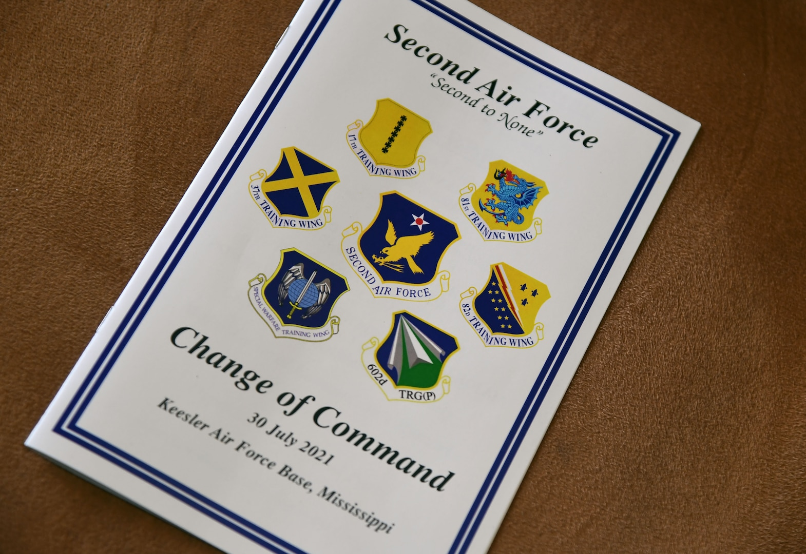 A pamphlet is on display during the Second Air Force change of command ceremony inside the Bay Breeze Event Center at Keesler Air Force Base, Mississippi, July 30, 2021. The ceremony is a symbol of command being exchanged from one commander to the next. Maj. Gen. Andrea Tullos relinquished command of the Second Air Force to Maj. Gen. Michele Edmondson. (U.S. Air Force photo by Kemberly Groue)