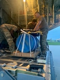 """A team of U.S. Air Force Airmen load an airdrop bundle of medical supplies onto a U.S. Air Force C-130J Super Hercules, call sign """"KANTO 92,"""" assigned to 36th Airlift Squadron deployed from Yokota Air Force Base, Japan, at Andersen Air Force Base, Guam, July 25, 2021. Members from U.S. Air Force, U.S. Navy, U.S. Coast Guard worked together to provide lifesaving assistance to a U.S. Army Soldier after the individual sustained an injury while at sea on an Army Watercraft System during Exercise Forager 21."""