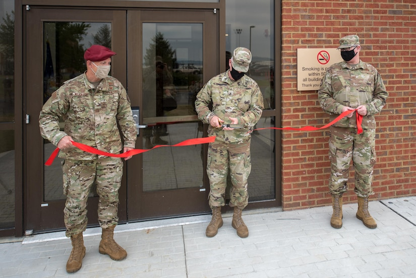 Brig. Gen. Hal Lamberton (center), adjutant general for the Commonwealth of Kentucky, cuts a ribbon held by Col. David Mounkes (right), commander of the 123rd Airlift Wing, and Brig. Gen. Jeffrey Wilkinson, assistant adjutant general for Air, Kentucky Air National Guard, during the dedication of a new Response Forces Facility at the Kentucky Air National Guard Base in Louisville, Ky., July 30, 2021. The 28,000-square-foot building will house the 123rd Security Forces Squadron, the 123rd Contingency Response Group, a Fatality Search and Recovery Team, and a medical detachment for the state's Chemical, Biological, Radiological, Nuclear and high-yield Explosive Enhanced Response Force Package. (U.S. Air National Guard photo by Phil Speck)