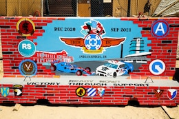 """The completed T-wall for the 310th Sustainment Command (Expeditionary) at Camp Arifjan, Kuwait.  Chief Warrant Officer 2 Paul Viall worked countless hours in extreme heat to paint a mural that will represent the hard work and dedication of the Army Reserve's Indianapolis-based """"Brickyard"""" Soldiers and their time serving within the U.S. Central Command's area of responsibility."""