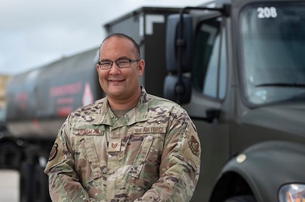 U.S. Air Force Tech. Sgt. Jason Ornellas, noncommissioned officer in charge of the Fuels Environmental and Safety office assigned to the 36th Logistics Readiness Squadron stands in front of one of his fuel trucks at Andersen Air Force Base, Guam, May 27, 2021. The 36th LRS provides Andersen AFB with the full spectrum of logistics support to include operating the largest fuel storage location in the Air Force and overseeing the installation deployment and reception operations. (U.S. Air Force photo by Senior Airman Helena Owens)