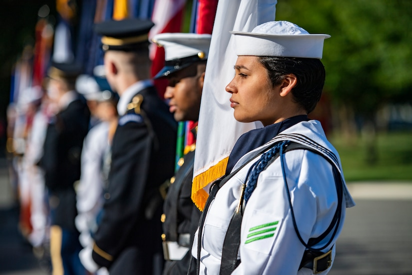 A group of service members stand in a line.