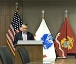 Man speaks at podium