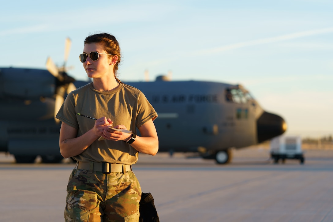 U.S. Air Force Staff Sgt. Megan Lenling, 133rd Air Transportation Function, observes flight line operations for the Air Terminal Operations Center in Yuma, Ariz., Feb. 22, 2021.