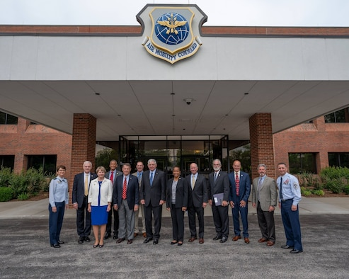 Gen. Jacqueline Van Ovost, Air Mobility Command commander, far left, and Chief Master Sgt. Brian Kruzelnick, AMC command chief, far right, gather with former AMC senior leaders at Scott Air Force Base, Illinois, May 27, 2021. For the first time, former commanders and command chiefs met to formally collaborate on efforts concerning the Mobility Air Forces during the Mobility Statesmen symposium.