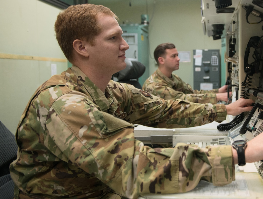 1st Lt. Joseph Bruno, 10th MS missileer, left, and Capt. Ryan Huston, 10th Missile Squadron mission lead combat crew commander, right, perform a training simulation intercontinental ballistic missile launch, inside the missile procedures training simulator May 27, 2021 at Malmstrom Air Force Base, Mont.