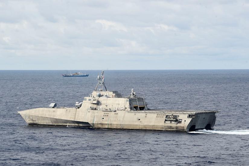 Ships maneuver in the South China Sea.