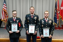 (From left to right) Staff Sgt. Scott Huish, Staff Sgt. Brad Carr, and Staff Sgt. Kedric Musselman show their steel de Fleury award after a ceremony at the Utah National Guard Headquarters May 22, 2021.