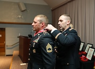 Col. Woodrow Miner, commander of the 204th Maneuver Enhancement Brigade, places the bronze de Fleury medal on Sgt. 1st Class Kevin Dimond, a member of the 118th Engineer Co. (Sapper), 1457th Engineer Battalion, in a ceremony at the Utah National Guard Headquarters May 22, 2021.