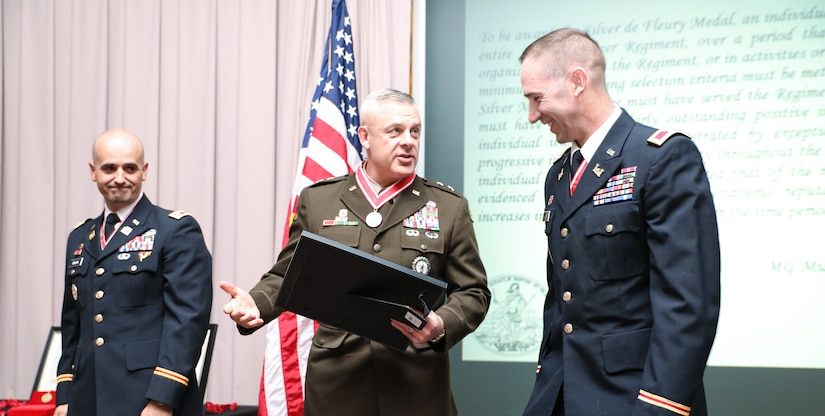 Maj. Gen. Michael Turley, the adjutant general of the Utah National Guard, accepts his silver de Fleury award from Col. Woodrow Miner, commander of the 204th Maneuver Enhancement Brigade and Lt. Col. Blake Bingham, commander of the 1457th Engineer Battalion in a ceremony at the Utah National Guard Headquarters May 22, 2021