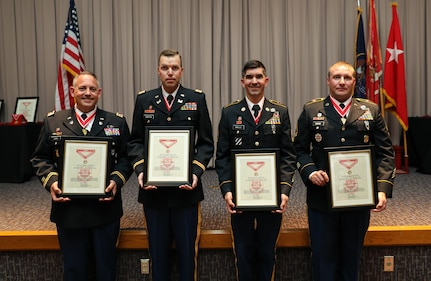 (From left to right) Lt. Col. Kevin Leitch, Capt. Nathan Griffin, Sgt. 1st Class Eric Dwelle, and Sgt. 1st Class Kevin Dimond show their bronze de Fleury award after a ceremony at the Utah National Guard Headquarters May 22, 2021.
