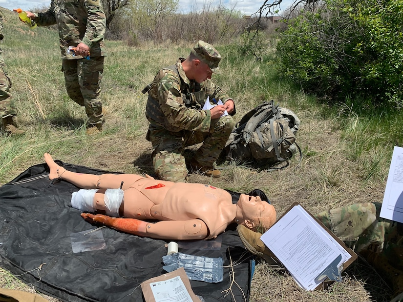 Soldier performs first-aid on dummy.