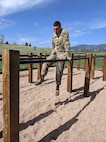 Soldier navigates obstacle course