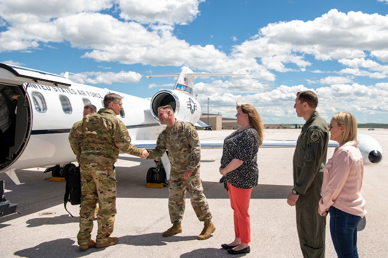Gen. Tim Ray, Air Force Global Strike Command commander, is greeted by Col. David Doss, 28th Bomb Wing commander, upon his arrival at Ellsworth Air Force Base, S.D., May 25, 2021.
