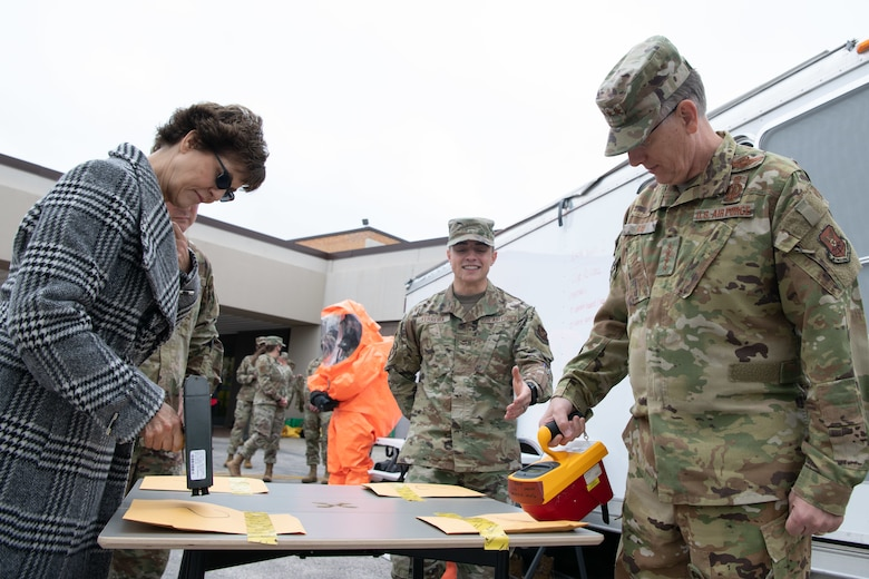 Rhonda Ray and her husband, Gen. Tim Ray, Air Force Global Strike Command commander, use a Geiger counter during a radioactive material identification demonstration at the 28th Medical Group on Ellsworth Air Force Base, S.D., May 26, 2021.