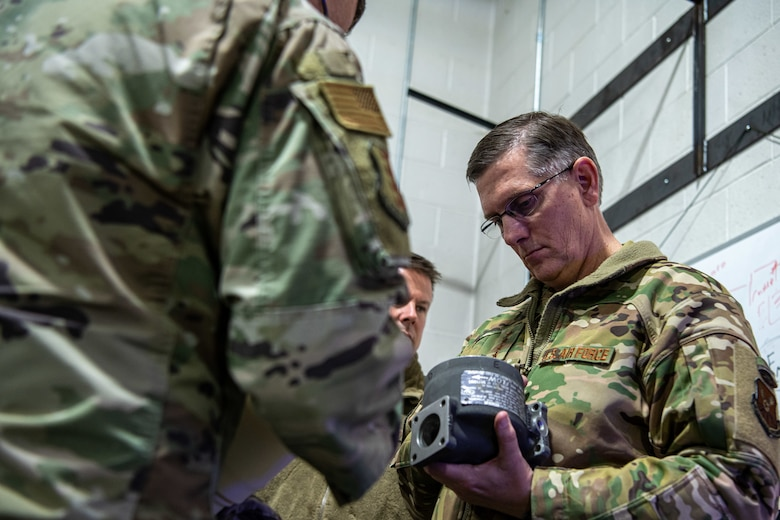 Gen. Tim Ray, Air Force Global Strike Command commander, receives information on equipment being used to maintain the B-1B Lancer fleet on Ellsworth Air Force Base, S.D., during a tour on May 26, 2021.