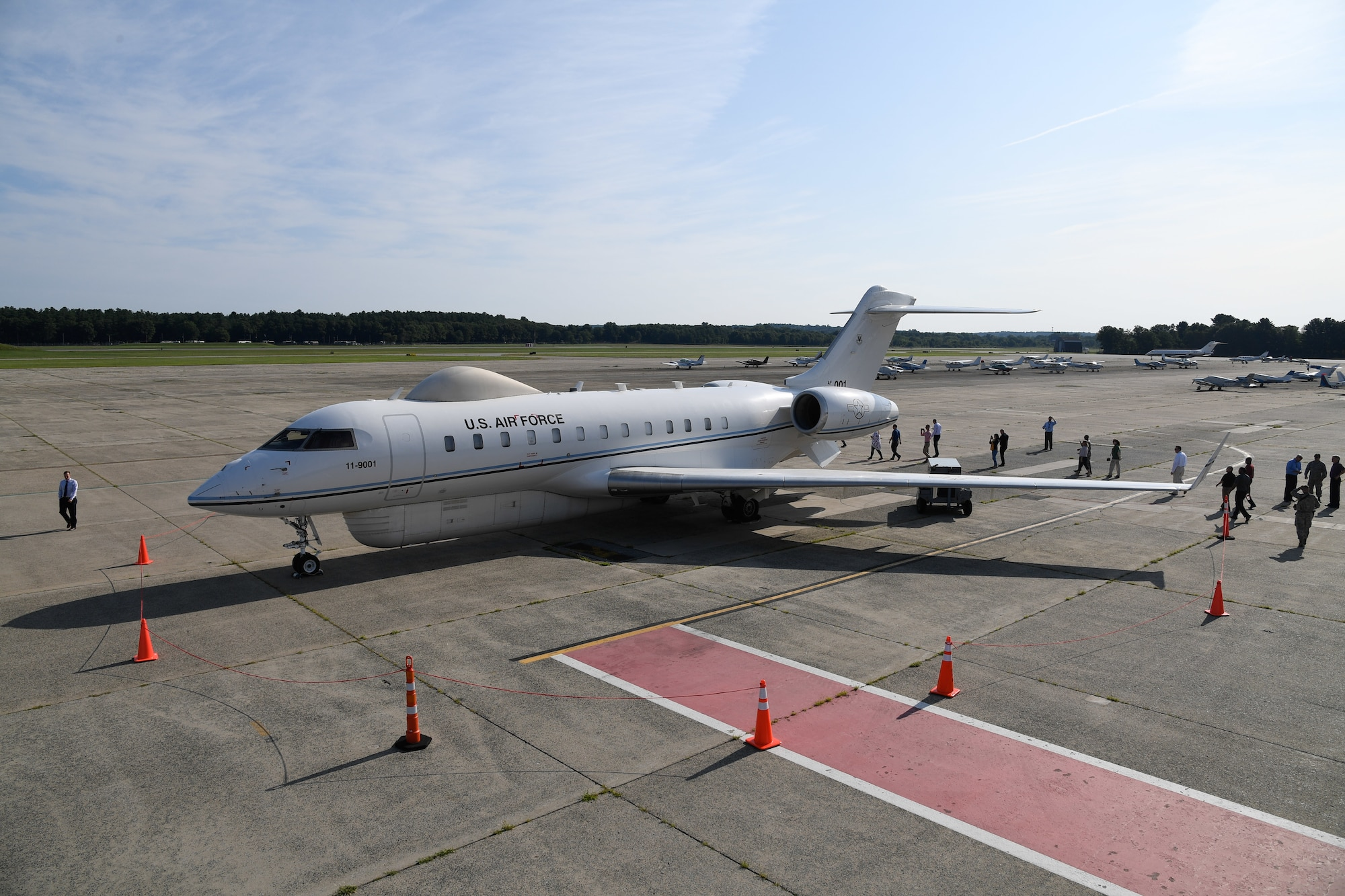 A Battlefield Airborne Communications Node-equipped E-11A aircraft rolls out on the flightline at Hanscom Air Force Base, Mass., in July 2018. On June 1, 2021, the BACN program office at Hanscom AFB awarded a $464.8 million contract to Learjet, Inc., a U.S. subsidiary of the Specialized Aircraft Division of Bombardier Inc., for up to six Bombardier Global 6000 aircraft with a five-year delivery period.