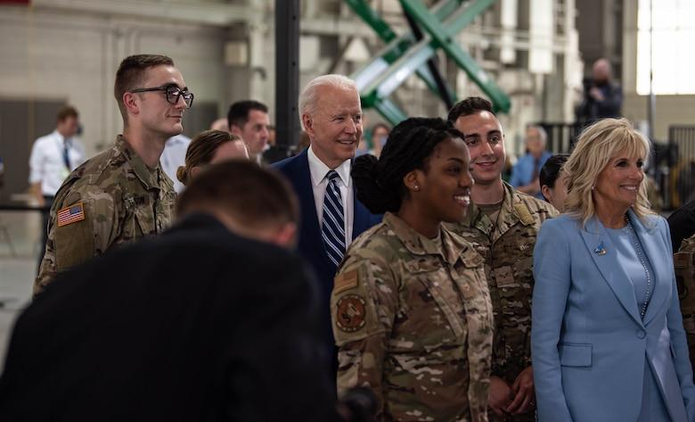 President Joe Biden and first lady Jill Biden interact with service members.